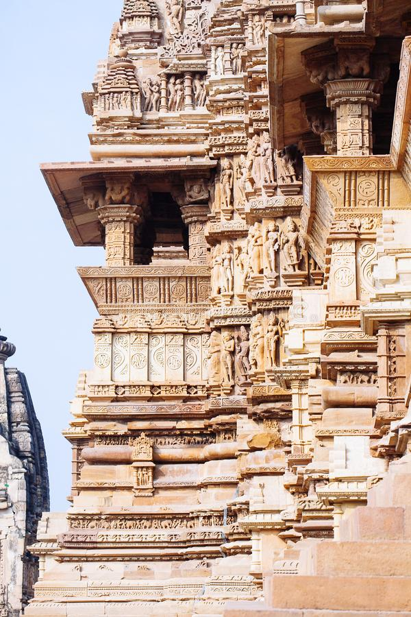 Ancient bas-relief at famous erotic temple in Khajuraho, India. stock photo