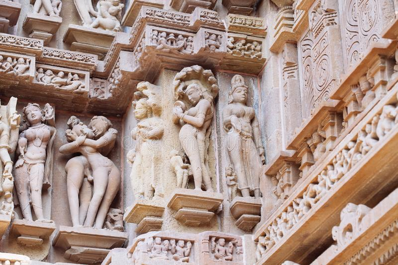 Ancient bas-relief at famous erotic temple in Khajuraho, India royalty free stock photography