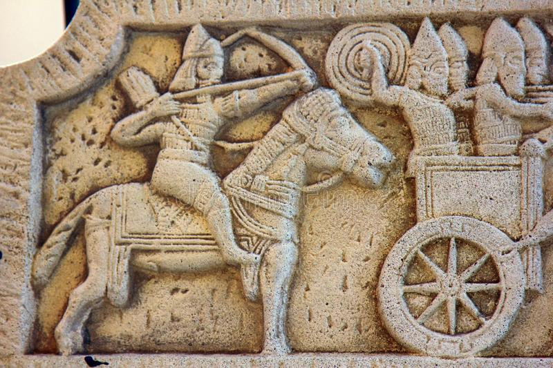 Ancient bas-reliefs on the Windows and walls of historical buildings. Architectural design elements from the past. The Assyrian warriors. Leoret de Mar stock image