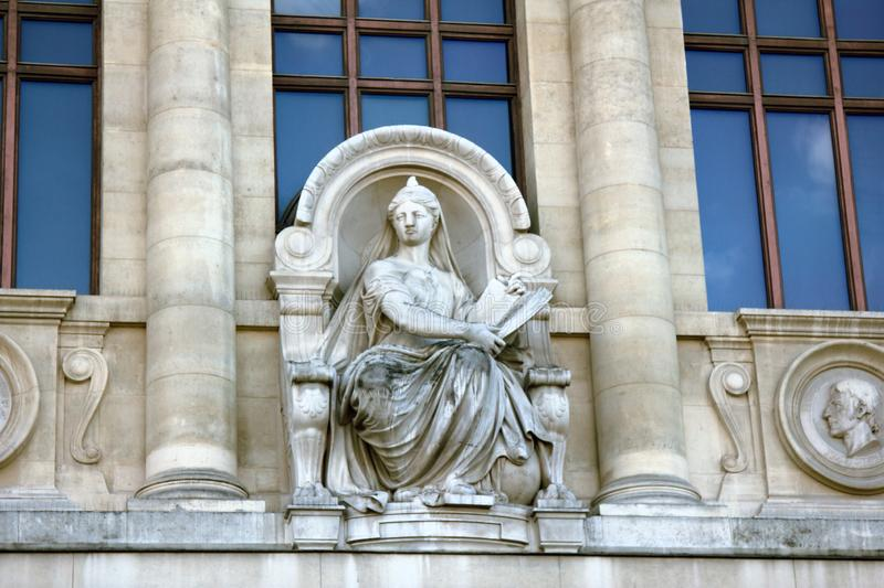 Ancient bas-reliefs on the Windows and walls of historical buildings. Architectural design elements from the past. The sculpture of the enlightenment. Paris royalty free stock photography