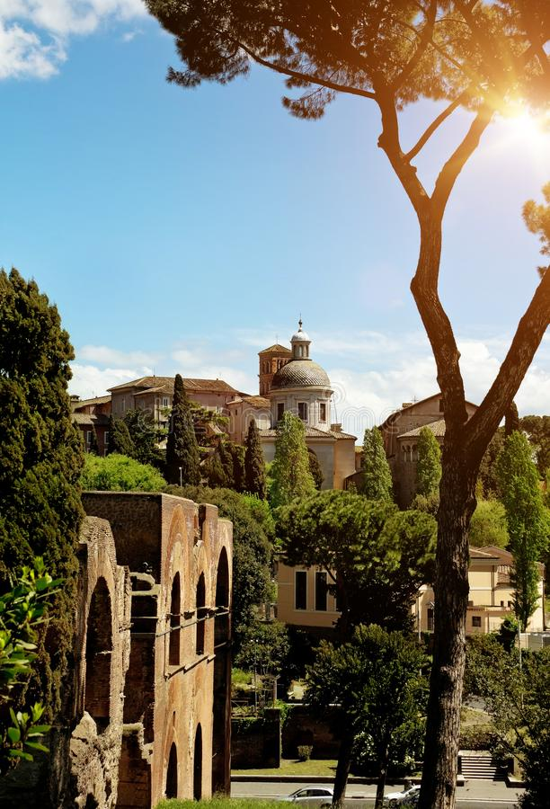 Ancient basilica church Santi Giovanni e Paolo, Roma, Italy. Ancient basilica church Santi Giovanni e Paolo located on the Caelian Hill, view from Roman Forum royalty free stock images