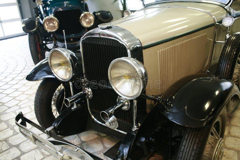 Ancient beautiful cars on parking stock photos