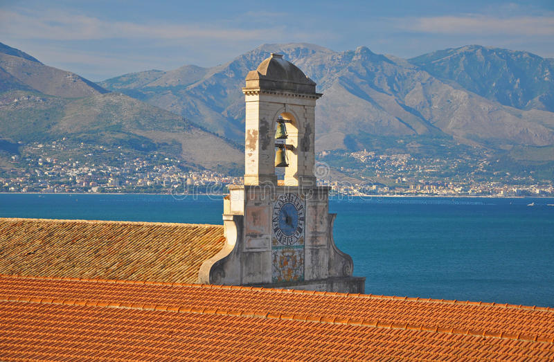 Ancient bell tower with a chapel in Gaeta on the background of s royalty free stock image