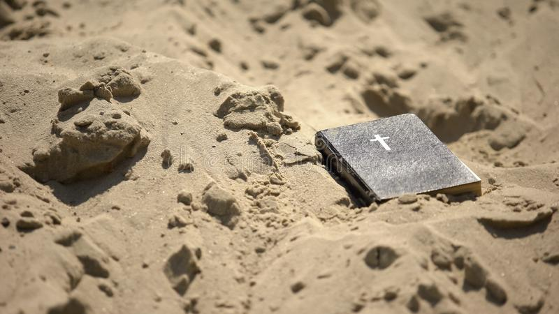 Ancient Bible abandoned in deserted place, concept of faith rejection, atheism royalty free stock image
