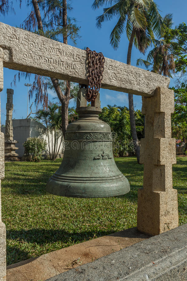 Ancient big bronze and iron bell with carvings hanging from a concrete support, Chennai, Tamil nadu, India, Jan 29 2017 stock images
