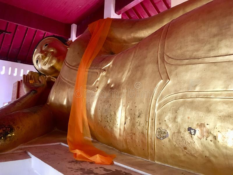 Reclining Buddha at Northern Thailand temple. Ancient biggest reclining buddha posture sleep Lanna style at Northern Thailand temple stock image