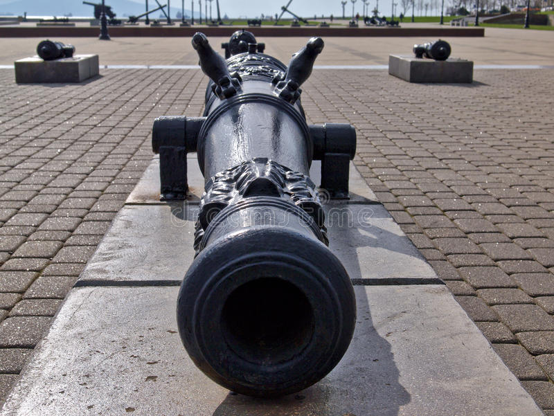 Ancient black cannon. Free open air museum of ancient cannons in Novorossiysk, Russia. Ancient black cannon. Free open air museum of ancient cannons and anchors royalty free stock image