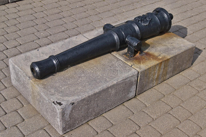 Ancient black gun barrel in the free open air museum in Novorossiysk, Russia. Ancient black gun barrel. Free open air museum of ancient cannons and anchors royalty free stock photo