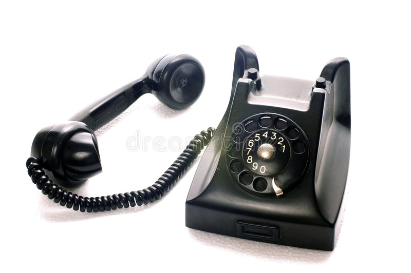 An ancient black phone with the handle beside stock photos