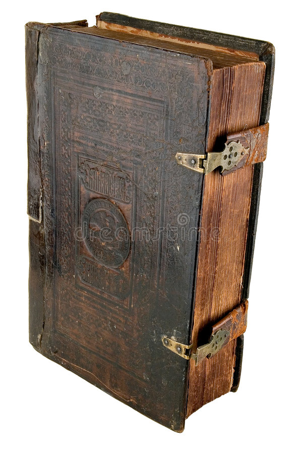 The ancient book. In leather reliure on a light background stock photo