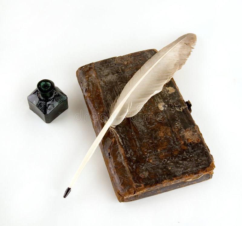The ancient book. And goose feather royalty free stock photo