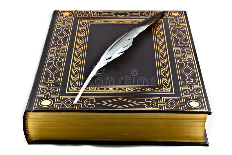 Ancient book and feather stock image