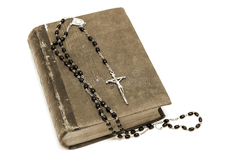 Ancient book and prayer beads stock images