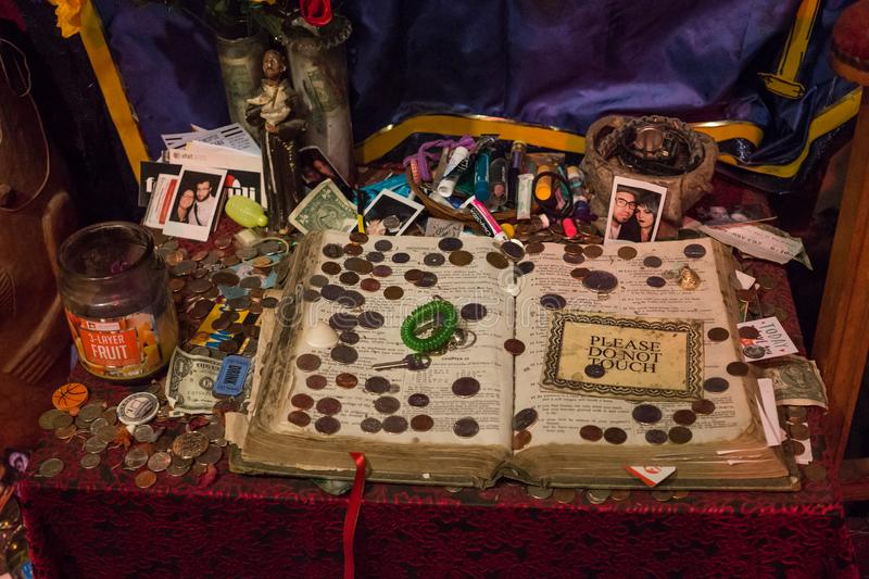 Ancient book of voodoo spells. Exhibition in the Museum of Voodoo History, New Orleans, Louisiana, USA stock photography