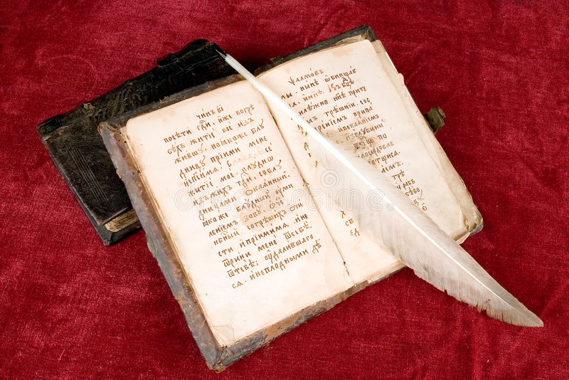The ancient books. The ancient book and goose feather royalty free stock photography