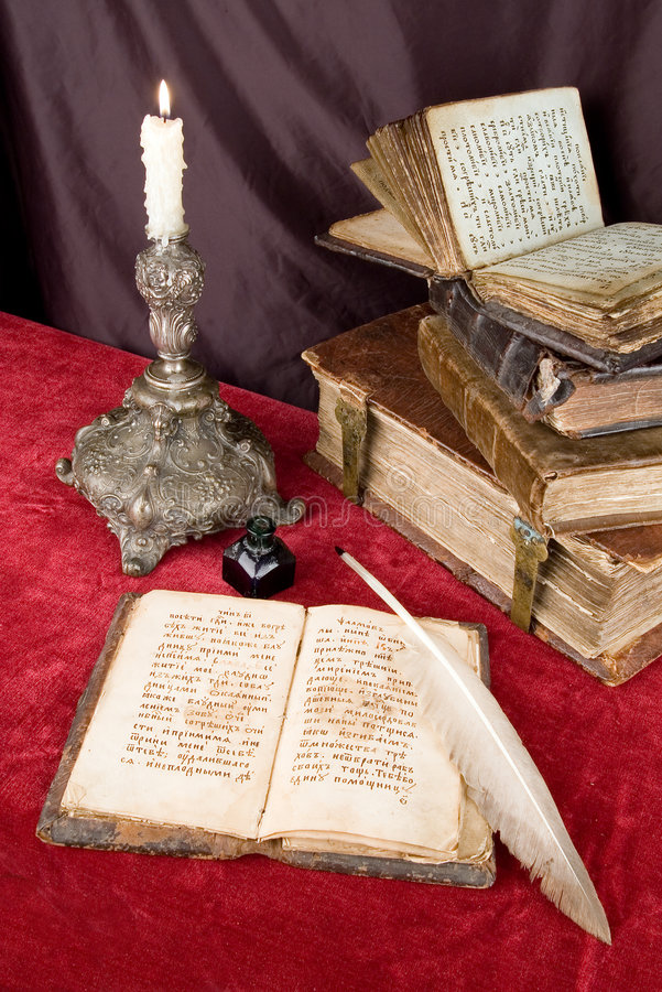 The ancient books. The ancient book and old goose feather royalty free stock image