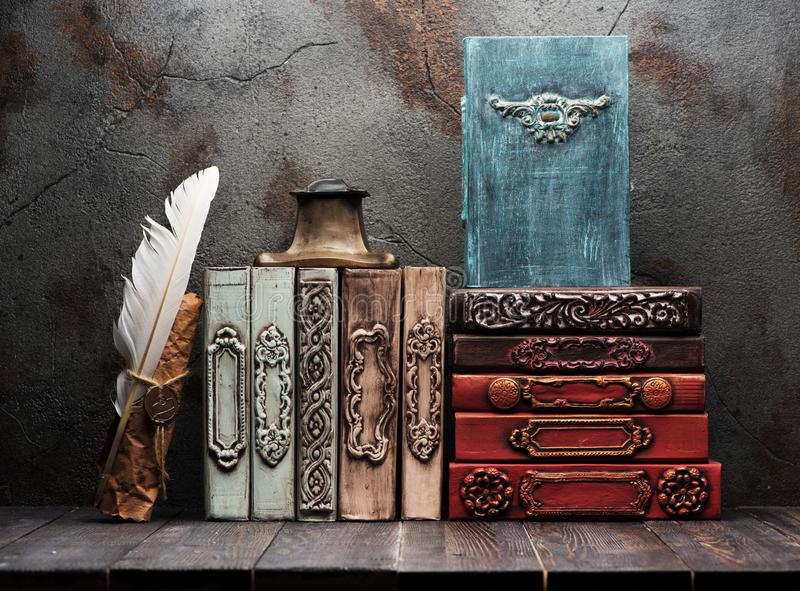Ancient books, manuscripts and antique inkwell royalty free stock photography