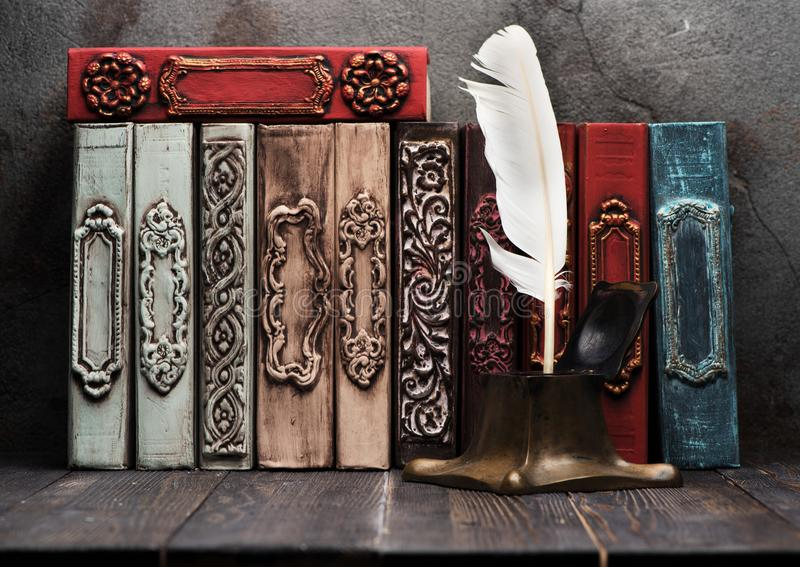 Ancient books on shelf and antique inkwell stock photography