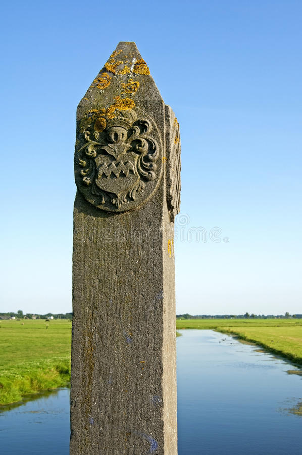 Ancient border pole in countryside between villages. The Netherlands, Province of North Holland, Region, Kennemerland Region; Heiloo village: on the border royalty free stock photo