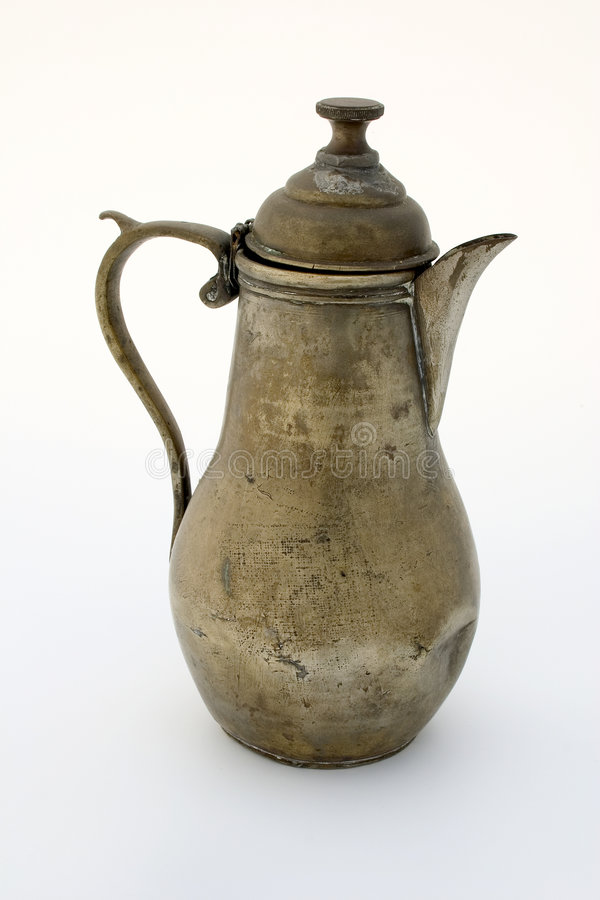 Ancient brass coffee pot royalty free stock photo