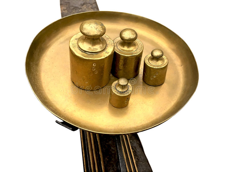 Ancient brass scales with weights stock photo