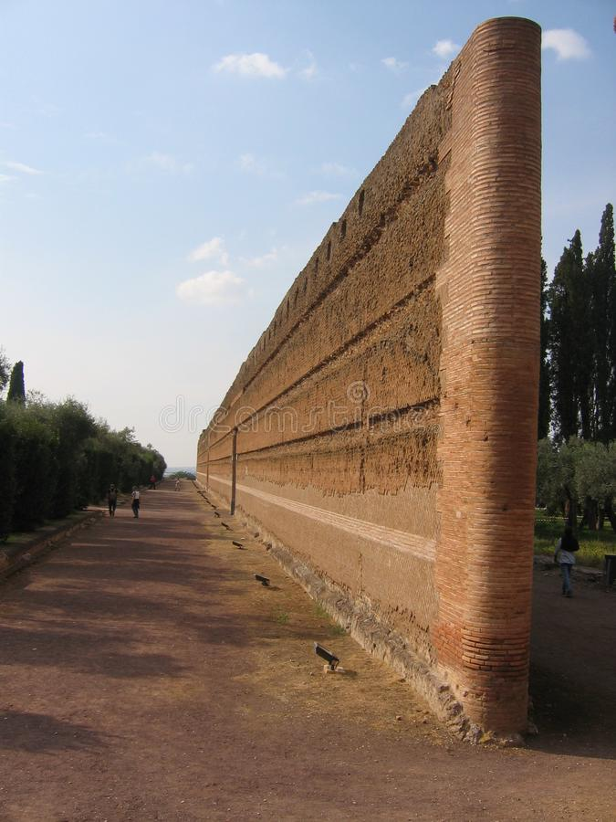 An ancient brick wall in the middle to a park to Tivoli in Italy. royalty free stock photo