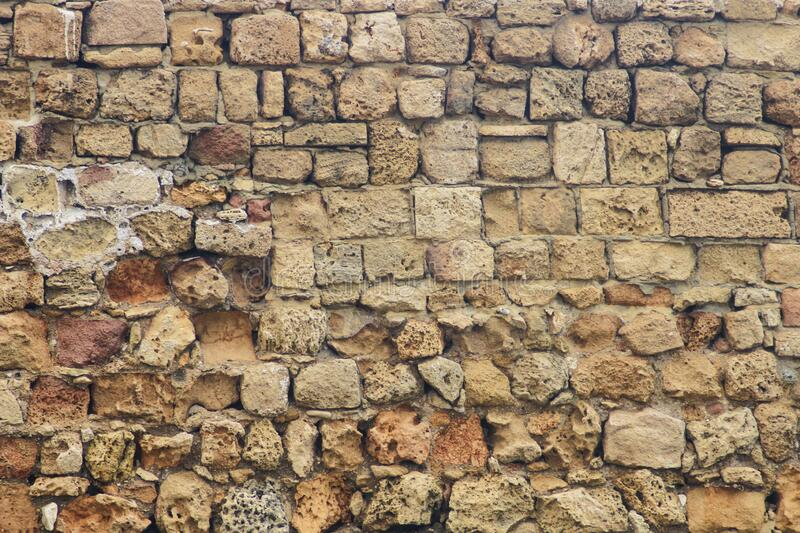 Ancient brickwork. Destroyed by time closeup as background royalty free stock image
