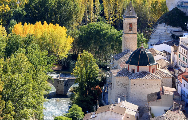 Ancient bridge ande church in Alcala del Jucar. Alcala del Jucar is located to the Northeast of the province of Albacete, where the Jucar river leaves Castilla royalty free stock photos