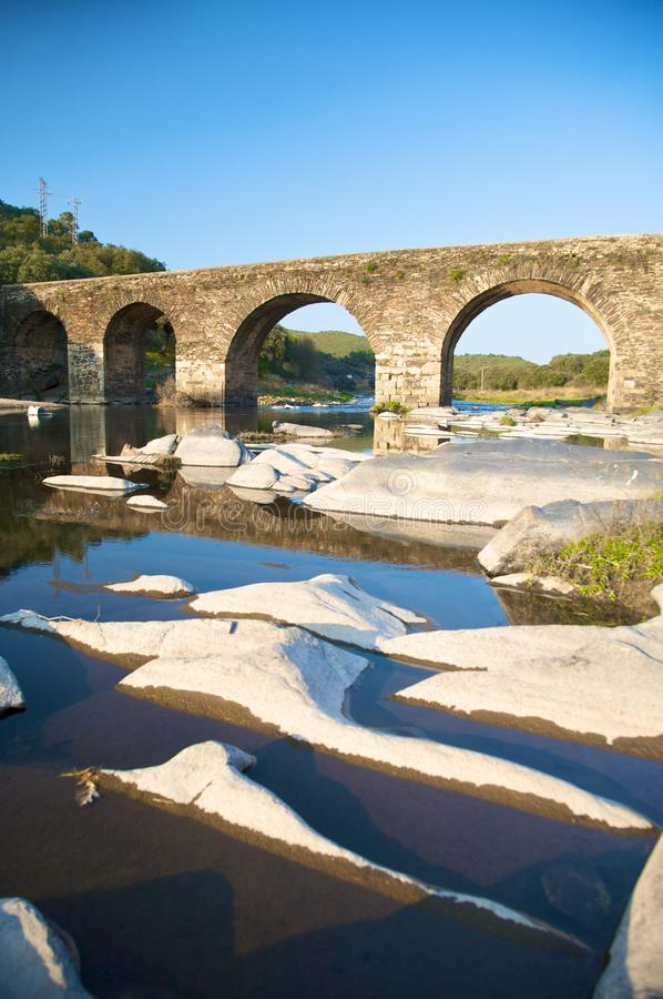 Ancient bridge and stone islands stock photography