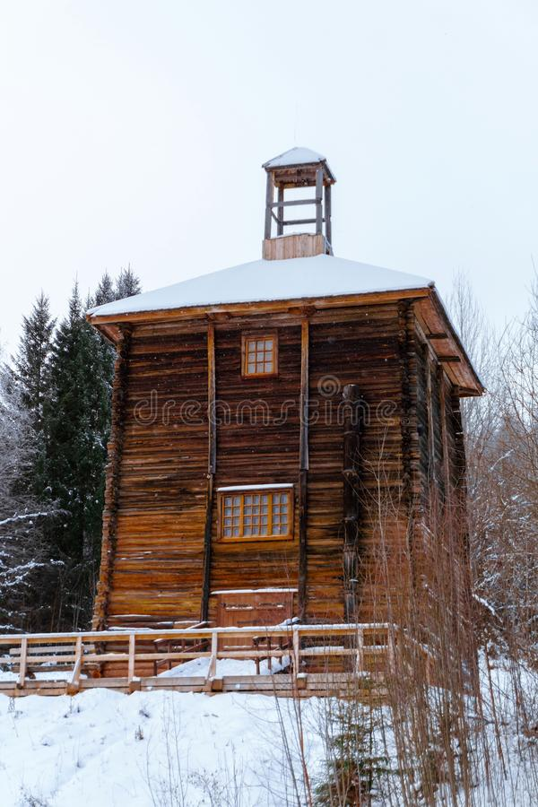 Old brine tower. Ancient brine-lifting tower - wooden log building representing an drilling rig above the salt deposit stock photo