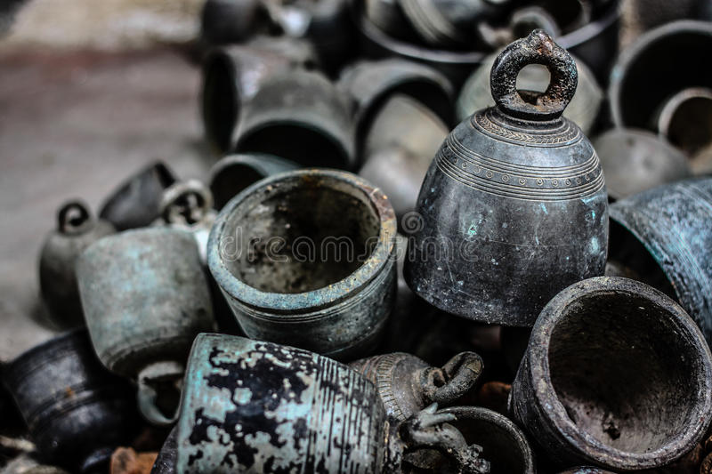 Ancient Bronze Bells. This is ancient southeast asia temple bronze bells in antique shop chiangmai Thailand royalty free stock photos