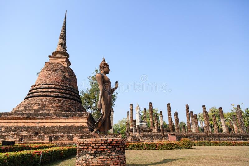 An ancient Buddha image at Sukhothai historical park royalty free stock photography