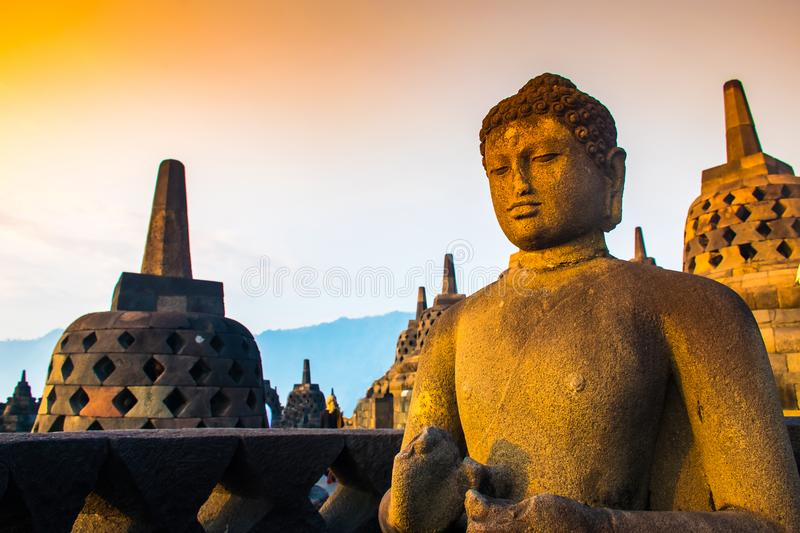 Ancient Buddha Statue of Buddhist temple complex Borobudur, Yogyakarta, Jawa, Indonesia stock photo