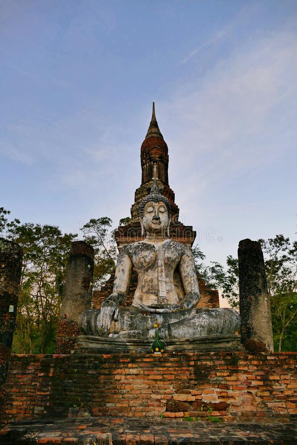 Ancient Buddha Statue inside The Historic Buddhist Temple Ruins in The Sukhothai Historical Park, Thailand at Dawn. Ancient Buddha Statue in The Sukhothai stock image