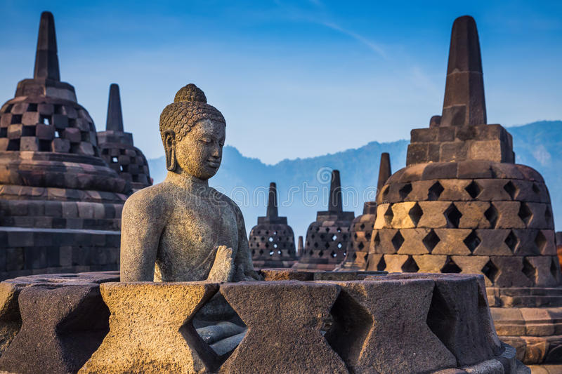 Ancient Buddha statue and stupa at Borobudur temple stock photo