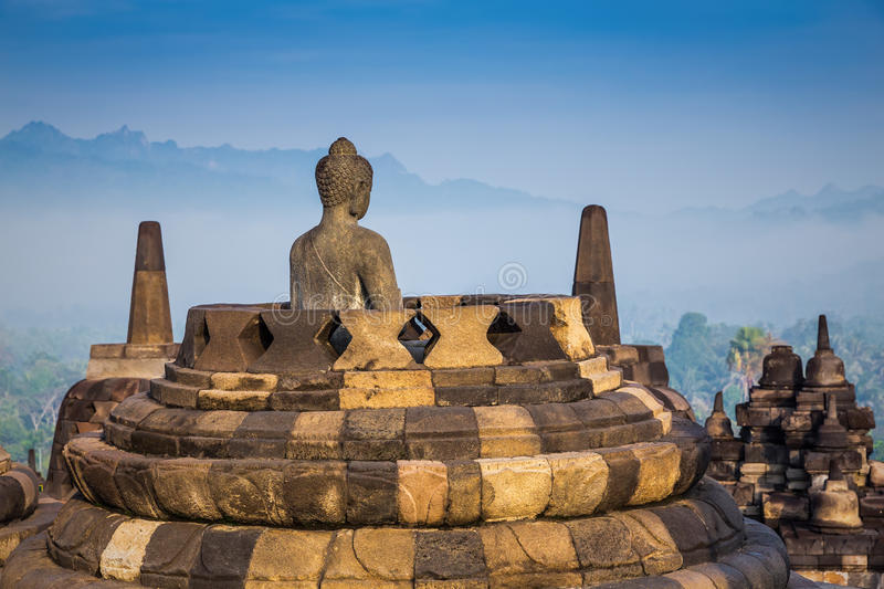 Ancient Buddha statue and stupa at Borobudur temple stock image