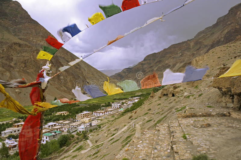 Ancient Buddhist Caves and Prayer Flags in the High-Altitude Mountain Desert royalty free stock images