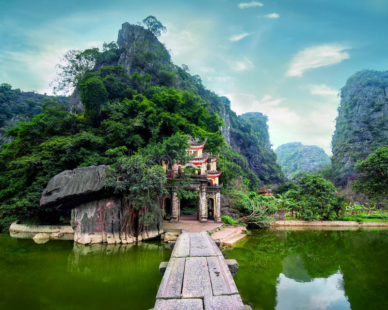 Ancient buddhist pagoda Bich Dong. Ninh Binh, Vietnam. King Dinh Tien Hoang temple BICH - FEB 21:Ha pagoda from Bich pagoda complex open its gates for the royalty free stock image