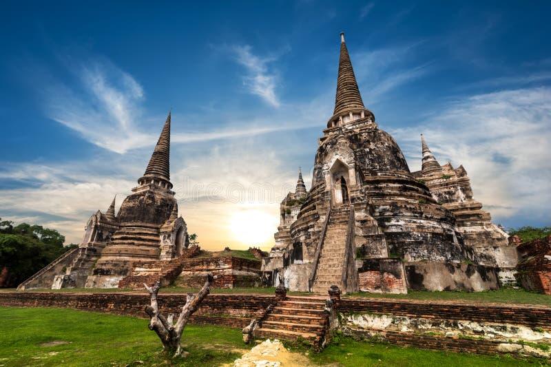 Ancient Buddhist pagoda ruins. Ayutthaya, Thailand. Asian religious architecture. Ancient Buddhist pagoda ruins at Wat Phra Sri Sanphet temple under sunset sky royalty free stock photos