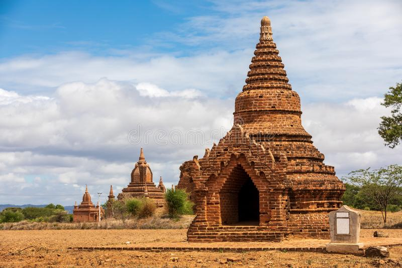 Ancient Buddhist pagoda temple in Mandalay in Burma, Myanmar. Lacality: Taungbi in the city of Nyaung-U in the Mandalay region. On a field with clear sky with stock image