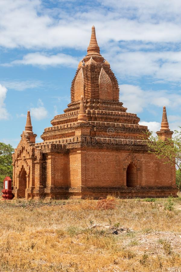 Ancient Buddhist pagoda temple in Mandalay in Burma, Myanmar. Locality: Leya in the city of Nyaung-U in the Mandalay region. On a field with sky with some stock photography