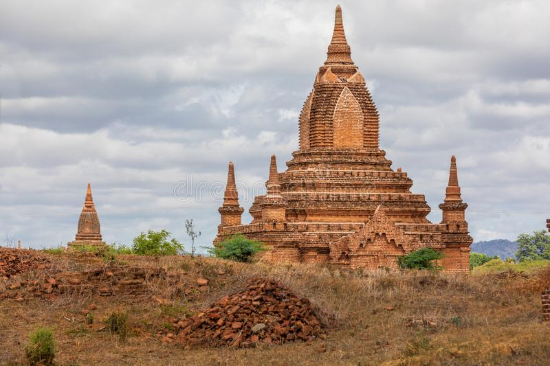 Ancient Buddhist pagoda temple in Mandalay in Burma, Myanmar. Locality: Leya in the city of Nyaung-U in the Mandalay region. On a field with sky with some royalty free stock image