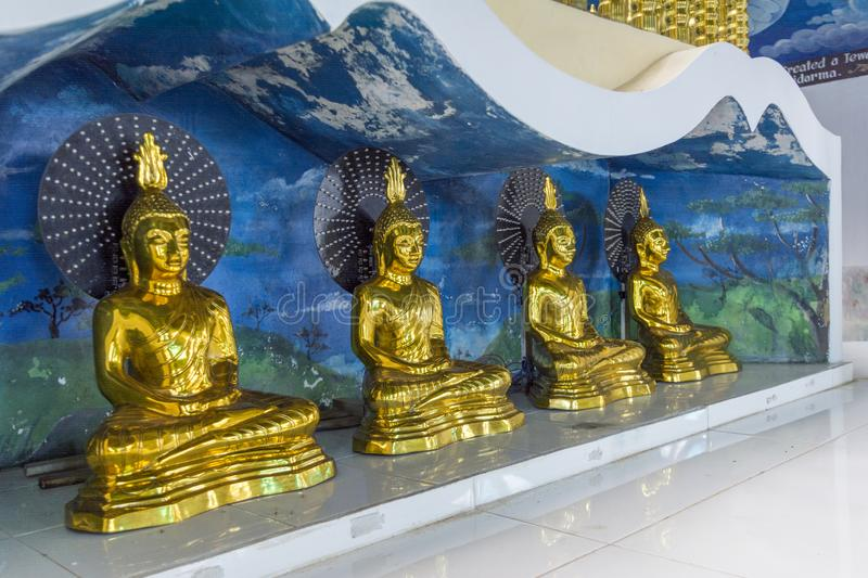 Ancient buddhist shiny golden color statues at the altar royalty free stock photos