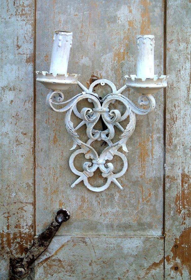 The ancient candelabrum. On the door stock photos