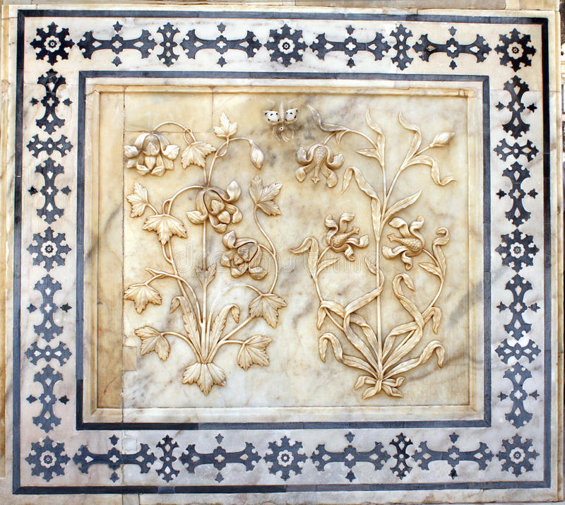 Ancient carved flower on marble in Amber Fort, Jaipur, Rajasthan, India royalty free stock image