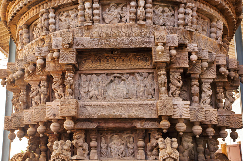 Ancient carvings in traditional Indian style, on ceremonial cart of Hindu temple. Patterns in India. Ancient carvings in traditional Indian style, on ceremonial royalty free stock photography