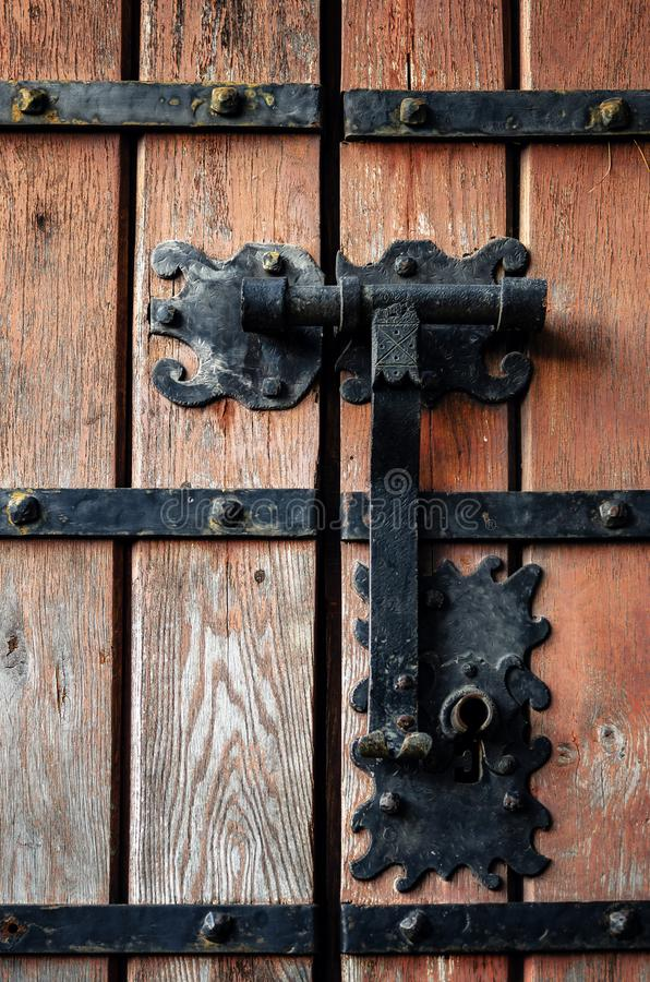 Ancient castle door lock. Ancient medieval castle door with iron knocker and lock royalty free stock photo