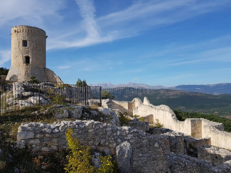 Ancient castle in l& x27;aquila, italy. Ancient castle, italy, landacape, mountains, ruins, sky, clean, tower, hills, aquila, fortress, watchtower, medieval stock image