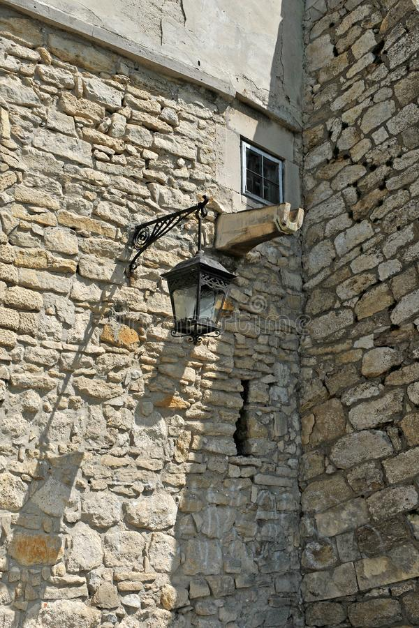 Ancient castle with street lamp, window and water pipe for the stock images