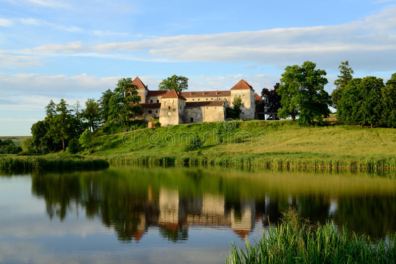 ancient castle Svirzh near the lake. Ukraine. stock images